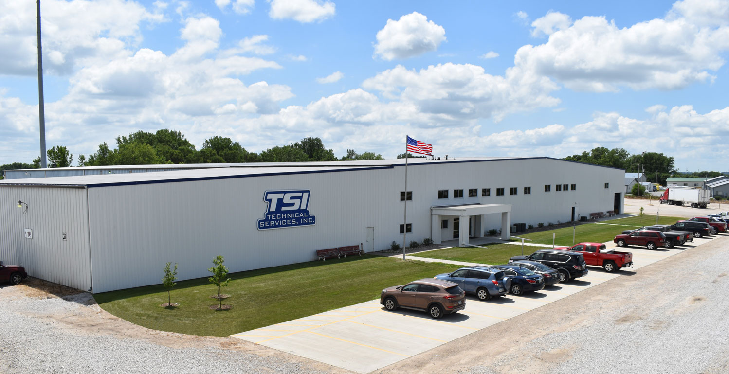 Aerial shot of TSI building on a sunny day with American Flag in front