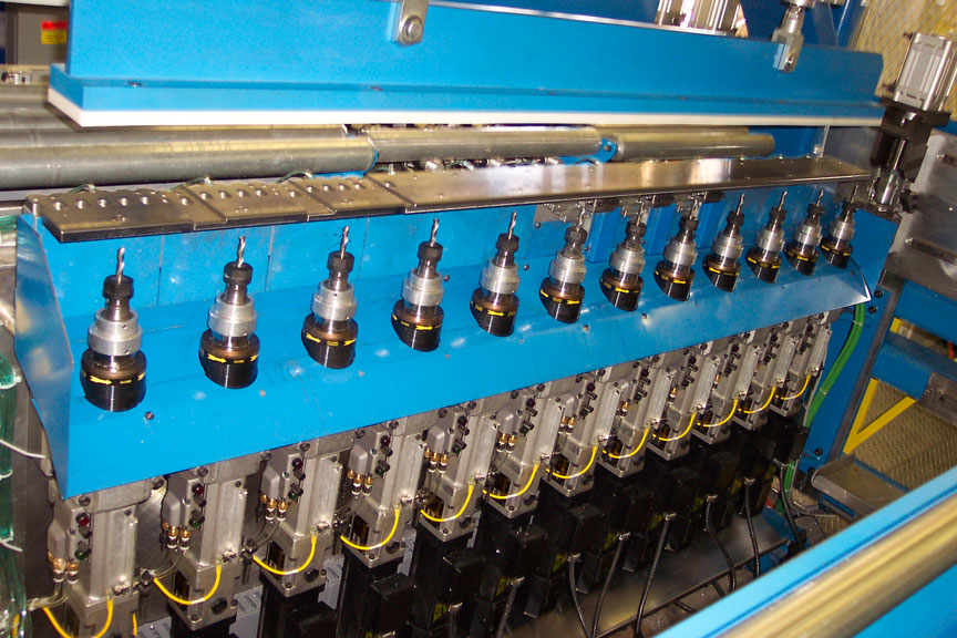 Servo driven position, multi-spindle drill machine