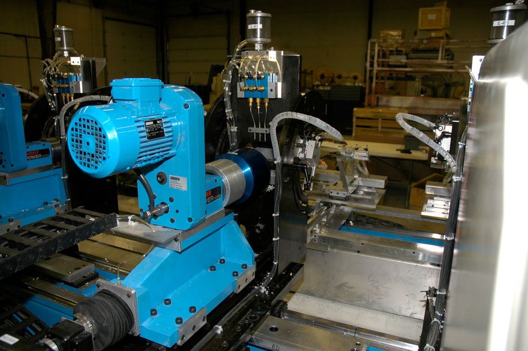 Servo controlled boring and drilling station