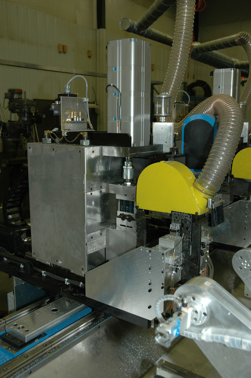 Automated sawing and punching station