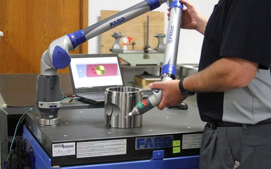 Faro CMM portable 3D measuring arm for determining accuracy of machined parts.
