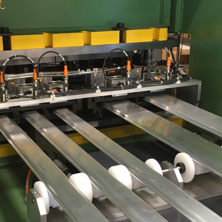 Multi part feeding and punching system